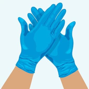 Handen met medische handschoenen