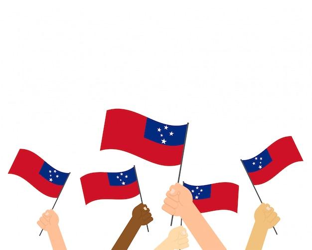 Handen met samoa vlaggen