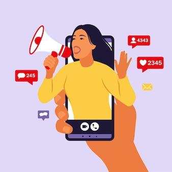 Handen met smartphone met een meisje dat in luide spreker schreeuwt
