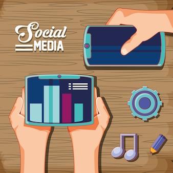 Handen met sociale media instellen pictogrammen op houten achtergrond