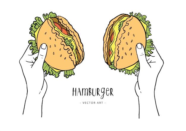 Handen scheuren hamburger in de helft