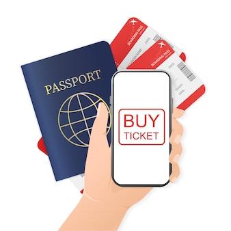 Handen, smartphone, paspoort en vliegtickets.