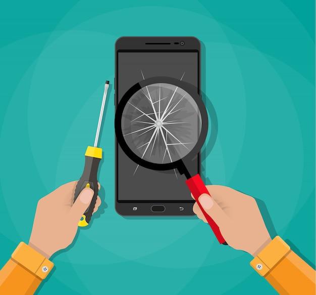 Handen, telefoon met gebroken scherm, schroevendraaier