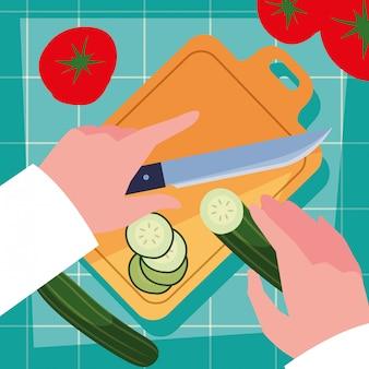 Handen van chef-kok met mes en keuken bord