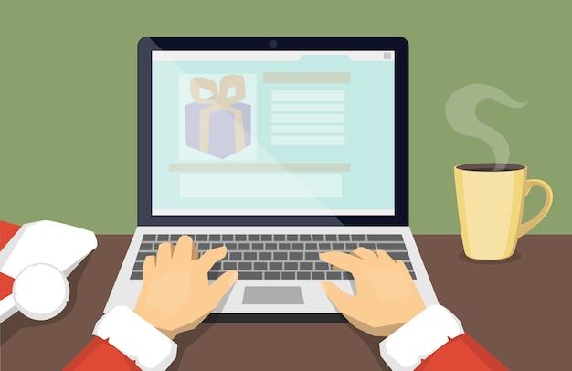 Handen van de kerstman die op laptop typen