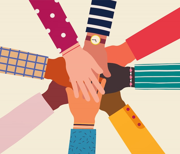Handen van diverse groep mensen samen.