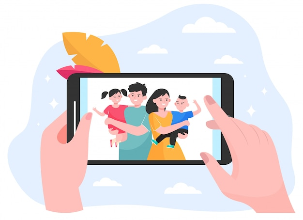 Handen van persoon die familie en kinderen op foto letten