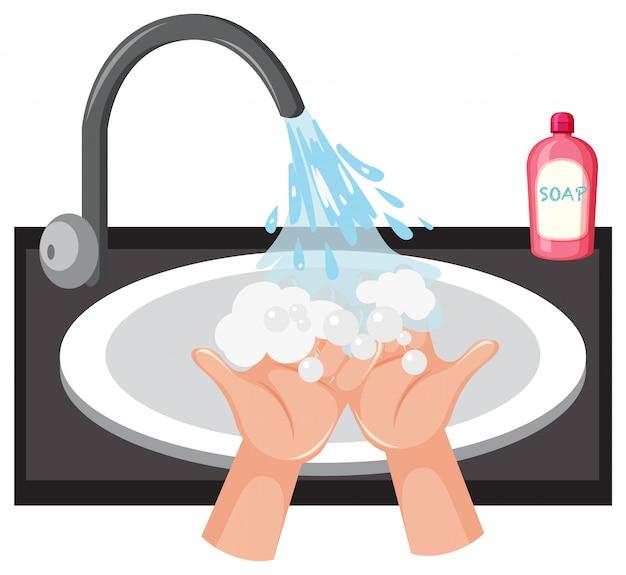 Handen wassen in de gootsteen met zeep