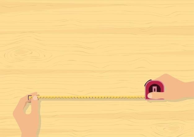 Handenband die op houten achtergrond meten