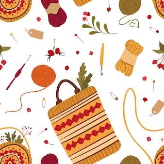 Handgemaakte tassen in volksstijl naadloos patroon gebreide vrouwelijke accessoires met etnische ornamenten