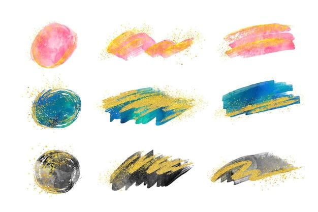 Handgeschilderde aquarel penseelstreken collectie met goud en glitter