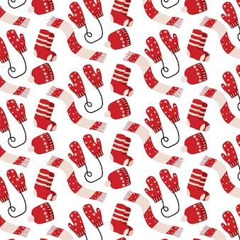 Handgetekend naadloos patroon met wanten, sokken en muts kerstpatroon