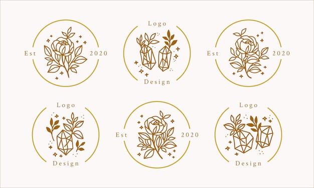 Handgetekend vrouwelijk schoonheidslogo met gouden bloemen, kristallen en sterren