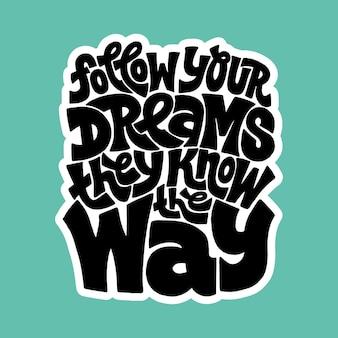 Handgetekende belettering citaat volg je dromen, ze kennen de weg zin voor zakelijke doelen