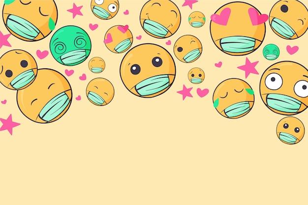Handgetekende emoji met gezichtsmaskerbehang