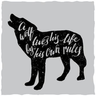 Handgetekende letters poster over wolf leeft zijn leven volgens zijn eigen regels