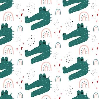 Handgetekende naadloze patroon voor kinderen met een krokodil krokodil regenboog en harten patroon