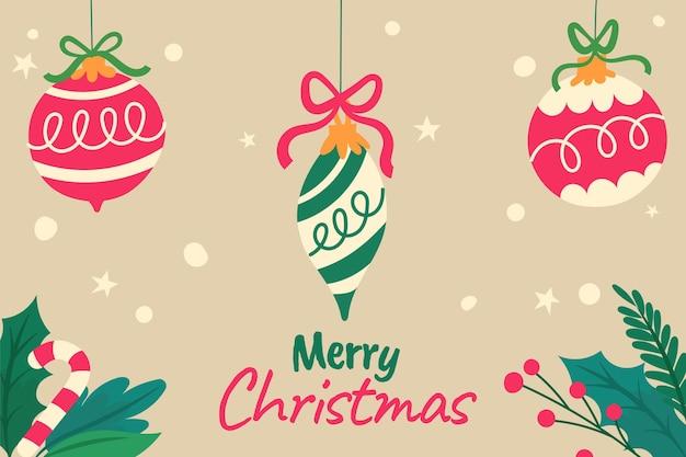 Handgetekende platte kerstachtergrond met ornamenten