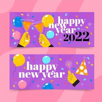 Handgetekende platte nieuwjaars horizontale banners met handen in een gejuich