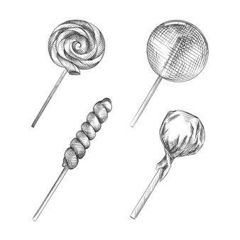 Handgetekende schets set van lollies en sukkels. de set bestaat uit lolly, regenbooglolly, gedraaide lolly