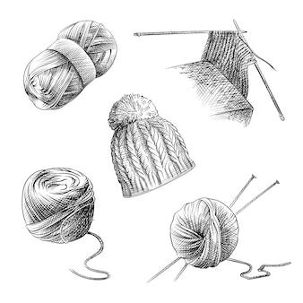 Handgetekende schets van breiset. de set bestaat uit breiwol, breinaalden tijdens het kneden, gebreide muts, ronde en langwerpige streng draad.