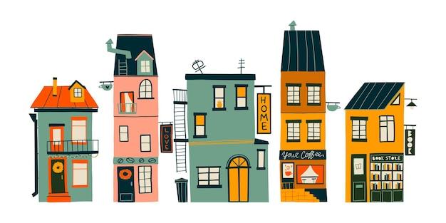 Handgetekende set met schattige gezellige huisjes. plat ontwerp. handgetekende trendy illustraties. gekleurde vectorillustratie. alle elementen zijn geïsoleerd
