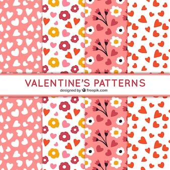 Handgetekende valentijnsdag patronen met hartjes en bloemen