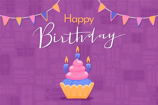 Handgetekende verjaardag achtergrond met cupcake en kaarsen