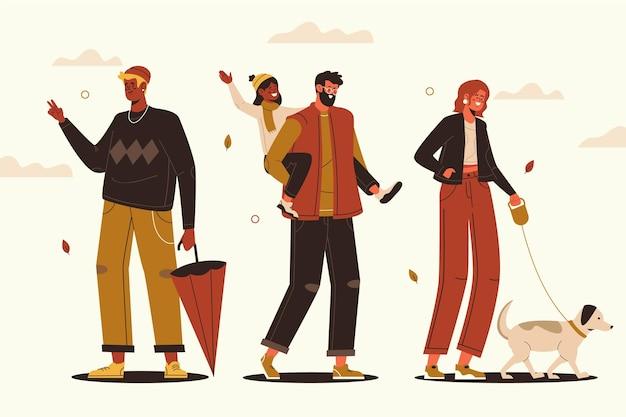 Handgetekende vlakke afbeelding van mensen in de herfst