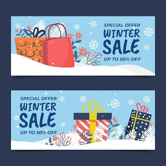 Handgetekende vlakke horizontale winterverkoopbanners met cadeautjes