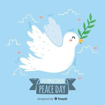Handgetekende vredesdag duif blauwe achtergrond