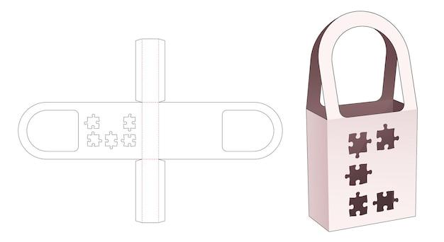 Handvatzakdoos met gestanste sjabloon in de vorm van een puzzel