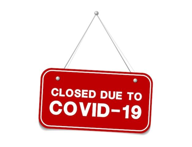 Hangend bord over coronavirus en close-up op een rood gesloten bord van een winkel die het bericht weergeeft
