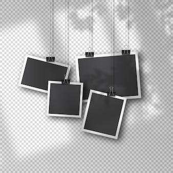 Hangende fotoset in vintage stijl op zachte transparante achtergrond. realistische retro fotosjablonen opgehangen aan metalen clips. zachte organische schaduwoverlay van raam en omgeving.