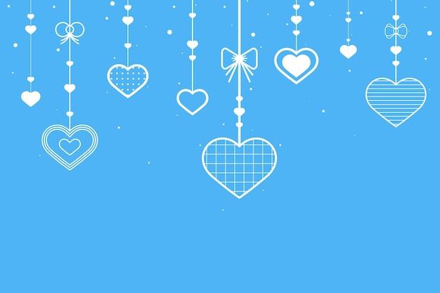 Hangende harten blauwe achtergrond