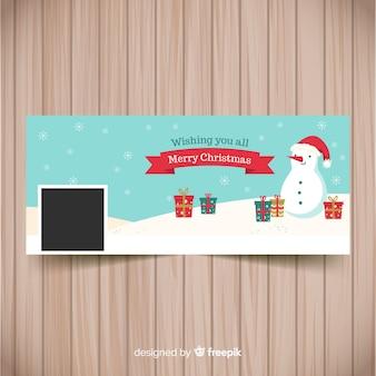 Hangende platte sneeuwpop kerst facebook omslag