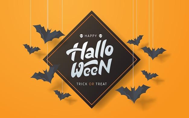 Happy halloween-kalligrafie met vliegende papieren vleermuizen.
