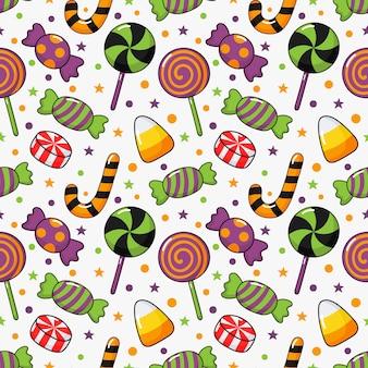 Happy halloween naadloze patroon en cartoon snoepjes geïsoleerd op wit