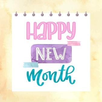 'happy new month' belettering met aquarelelementen