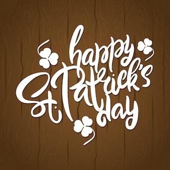 Happy saint patricks day letters in houten achtergrond afbeelding