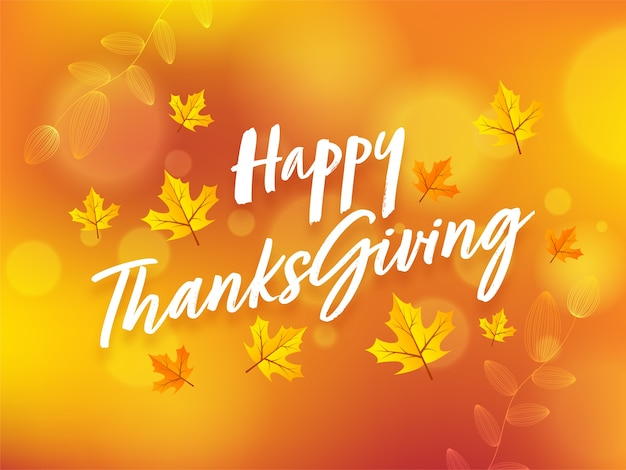 Happy thanksgiving-lettertype met herfstbladeren op oranje onscherpe achtergrond.