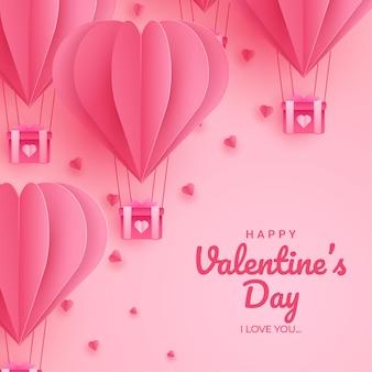 Happy valentijnsdag ontwerp met papier gesneden roze hartvorm hete lucht ballonnen vliegen Premium Vector