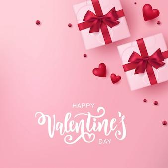 Happy valentine's day hand belettering typografie met realistisch ogende geschenkdozen en harten.
