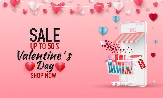 Happy valentine's day verkoop banner. online winkel met mobiel