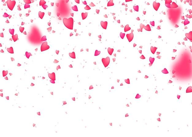Hart confetti achtergrond. vallen van bovenaf roze liefdesdeeltjes. wazig bloemblad.