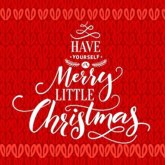 Heb jezelf een merry little christmas typography-kaart met letters op rode gebreide textuur