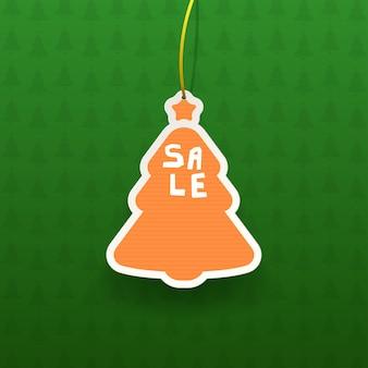 Helder kleurrijk kerstboomverkooplabel met realistische schaduw op groene gestructureerde achtergrond