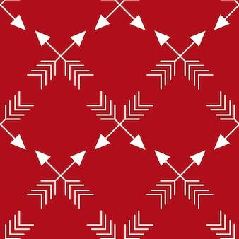 Heldere geometrische naadloze patroonachtergrond met repetitieve gekruiste pijlen op rode achtergrond voor chri...