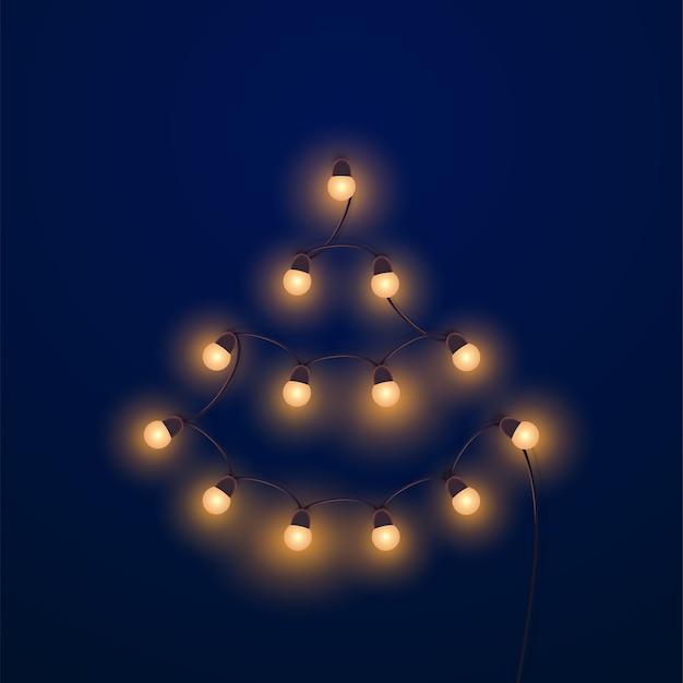 Heldere gouden slinger vormt kerstboom