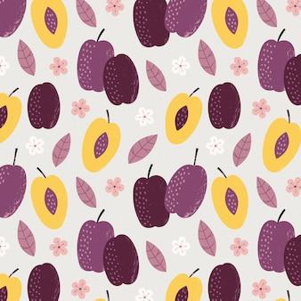 Helften van pruimfruit en bloemenpatroon